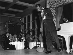 Nat King Cole preforming at Ciros - a very 'in' Hollywood dinner club - 1959 - Sid Avery photo held by Motion Pictures and Television photo archive.