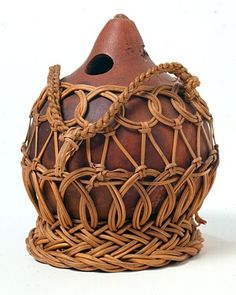 """Kew Gardens' Economic Botany collection: water bottle"" by Dyaks tribe / This water bottle made of a gourd and encased in a woven net, was most likely collected in Labuan, an island located off the Northwest coast of Borneo in the Asia Pacific region."