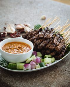 """""""Satay are found all over South-East Asia. In Singapore, these little flame-seared morsels are a popular and affordable street snack enjoyed at all hours of the day and night. You could substitute chicken, lamb or goat for the beef if you prefer.″ Adam Liaw, Destination Flavour Singapore"""