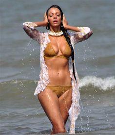 Judi Shekoni in golden bikini