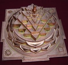 The Sri Yantra (shown here in the three-dimensional projection known as Sri Meru Chakra or Maha Meru used mainly in rituals of the Srividya Shakta sects) is central to most Tantric forms of Shaktism.