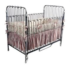 This hand forged iron crib by Corsican has a classic style and timeless appeal. Made by skilled craftsmen who uphold a tradition of handcrafted beauty, attention to detail and a commitment to quality