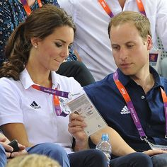 Love this picture of William checking her ID badge.  She has her hand on his knee.
