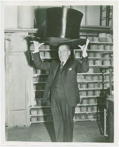 Max Fluegelman with world's largest top hat. New York World's Fair (1939-1940). NYPL Digital Gallery.
