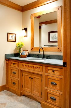 Mullet Cabinet - Mission-Style Main Bath accentuated with Curly Cherry wood grain.