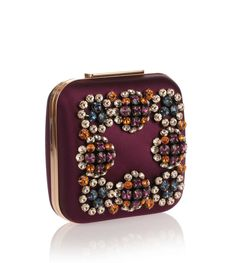 Purple silk clutch with multi-coloured Swarovski crystals from Manolo Blahnik. The Hangi has a gold-tone logo engraved clasp closure, an optional short and long chain, and nappa leather lining.Made in ItalyMeasurements: L17 x H15.8 x W7.3 cmHandle Drop: 37 / 110 cmDesigner colour: Mulberry