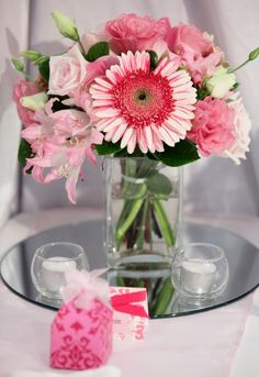 "Sweet in pink arrangement using Optic Votive Holders, 7 Hour Tea lights & our 3"" x 3"" x 6"" Square Vase  A simple and elegant wedding centerpiece"