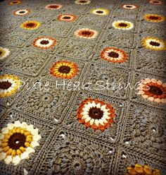 Sunburst Granny Afghan for Corinne with sunflowers like these and yellow ones with a navy blue background