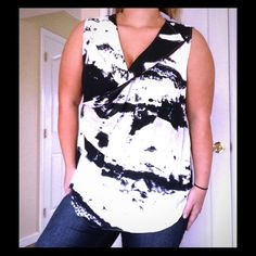 Sleeveless Abstract Splatter Top Elegant top with quirky , fun design. Zipper in front side , sheer material. 100% polyester FYLO Tops