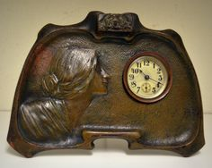 Art Nouveau clock 1900 era bronze lovely style.  Clock measures 6x8  condition is good clock might need some repair.