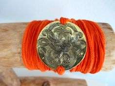 Orange Silk Wrap Medallion Charm Bracelet. Starting at $1 on Tophatter.com!