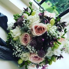 Brides bouquet of roses, gyp, phlox, astrantia and freesia at Askham Hall