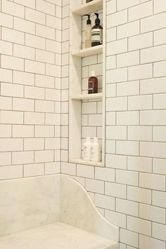 subway tile and marble lined shower niche with marble shelf Subway Tile Showers, Marble Showers, Subway Tiles, Wall Tiles, 12x24 Tile, Backsplash Tile, Shower Seat, Shower Niche, Master Shower