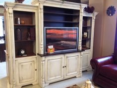Imagine how your home TV watching experience would transform with this wooden home entertainment center! #shopGF | Houston TX | Gallery Furniture |