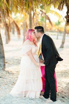 Beach elopement in Florida: http://www.stylemepretty.com/florida-weddings/miami-beach/2016/10/31/colorful-florida-beach-halloween-elopement-wedding/ Photography: Kati Rosado - http://www.katirosado.com/