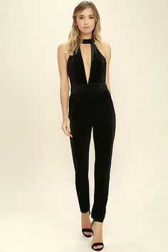 5a1215671db3 Every twirl you take in the Spin Me  Round Black Velvet Jumpsuit will have  all