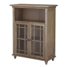 @Overstock.com - Corina 2 Door Floor Cabinet - This Corina cabinet features an attractive dark espresso finish and offers sleek lines for a modern look. The two glass doors are accented with grid-work design and beveled molding. Antique bronze door knobs showcase the modern design.  http://www.overstock.com/Home-Garden/Corina-2-Door-Floor-Cabinet/7211315/product.html?CID=214117 $114.98