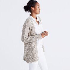 An easy open cardigan with a slouchy, no-fuss fit. Made of marled yarn in a classic cableknit pattern, this sweater layers perfectly over a pretty dress. <ul><li>Merino wool.</li><li>Hand wash.</li><li>Import.</li></ul>