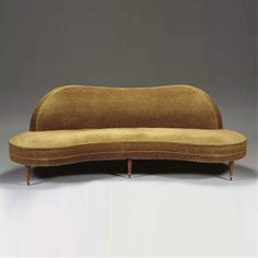 Upholstered 'Flaque d'eau' sofa by Jean Royere