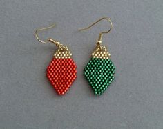 These beaded earrings depict a cute Scottie dog with his tongue hanging out. on a sky blue background. They measure about 1-1/4-inches wide and 3-inches long, excluding the ear wires and are woven using the brick stitch and approximately 1106 tiny seed beads and 34 czech fire polish beads. Although some people find bead work tedious, I really love it. There is something so fascinating about stitching the beads in place, one by one and watching the picture develop.  They would make a great…