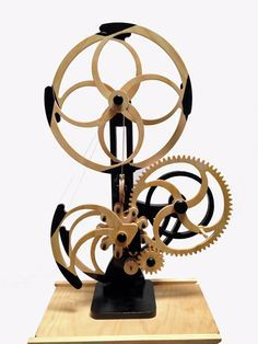 Woodworking Plans by Clayton Boyer, the Whirly Kinetic Sculpture Wooden Gear Clock, Wooden Gears, Wood Clocks, Cowgirl Decorations, Skeleton Clock, Kinetic Art, 3d Prints, Arts And Crafts Movement, Wood Sculpture