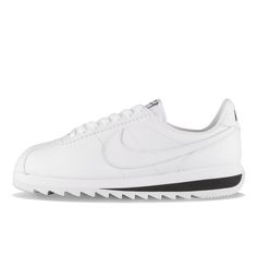 Nike WMNS Classic Cortez Epic PRM White / White / Black - Nike Womens The WMNS Nike Cortez Epic PRM in white has all leather uppers, a tonal swoosh, and an extra deep midsole. Contrasting white details finish the look.