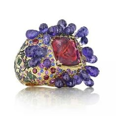 One-of-a-kind Madstone Bacchus ring with amethyst briolettes, a palette of coloured gemstones and a shank of creeping ivy