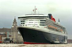 The Queen Mary 2 next to the Liver Building.  Queen Elizabeth and Queen Victoria will sail into the city and for a time all three ships of the Cunard fleet will line up on the Mersey.