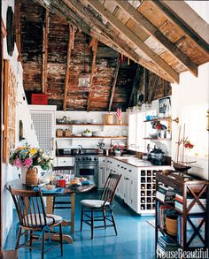 Color and gloss on floor! For decorative detail in this Palm Beach kitchen, designer Gary McBournie studied vintage boating posters and old photographs. The wooden grills of the kitchen cabinets were taken from an old photo of a 1920s yacht. - HouseBeautiful.com