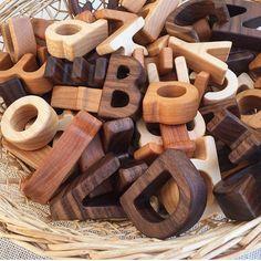 Little letters... #littletorquay #letthembelittle #littlelearning #learningforlife #surfcoast #torquay #greatoceanroad #play #nature #natureplay #playbasedlearning #earlyyears #earlychildhoodeducation #creativity #woodentoys #alphabet : @treasuresfromjennifer