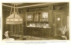 """Dining Room with inlaid doors and recesses for vases. From """"The Home Beautiful,"""" 1915."""