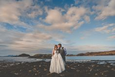 Scottish highlands. Wedding photography. Autumn/fall wedding with glorious sunshine on the beach.   A-line, lace wedding dress.