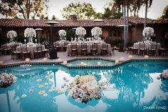Poolside #wedding by Karen Tran flower arrangements floating in pool