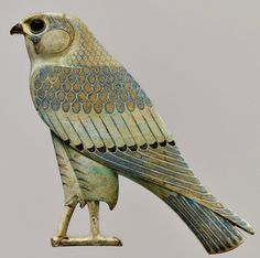 The God Horus in His form of sacred falcon; faience inlay from Khmoun/Shmoun (Hermopolis Megale), IV century BCE. Now in the Metropolitan Museum.