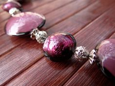 """HOLLY   Murano glass parure di VenetianPearls su Etsy.  In this necklace the Murano glass beads are created using a white glass base """"submerged"""", or gold leaf """"submerged"""", that is melted in the core of the violet bead itself. A thread of small silver beads and small metal parts (nichel-free) links the glass beads, creating an elegant and young-looking effect, an accessory suited both for day and night, in any season."""