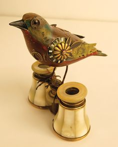 Bird Watching  Perched on antique opera glasses, this bird is adorned with recycled items—$310 at Eclectic Collector  215 Katonah Ave  Katonah  (914 232-8700  theeclecticcollector.com