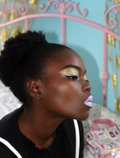 High glam afro puff.  A burst of spring. (1) Tumblr