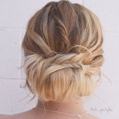 Bridal updo. Low loose bun with a braid. For more hair inspiration check out Instagram: @wb_upstyle