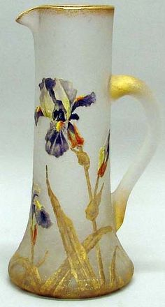 A tall art glass frosted pitcher having enamel floral decoration, spreading vase. circa ?