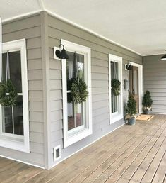 47 Rustic Farmhouse Porch Decorating Ideas to Show Off This Season House Paint Exterior, Exterior House Colors, Exterior Design, Farmhouse Exterior Colors, Grey Siding House, Siding Colors For Houses, Exterior Doors, Farmhouse Front Porches, Rustic Farmhouse