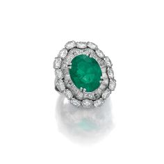 An emerald and diamond ring by Van Cleef & Arpels.