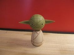 Kokeshi Doll. Yoda inspired custom. $25.00, via Etsy.