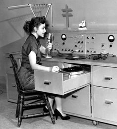 Female DJ spinning records, 1950s