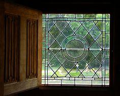 Leaded glass window with shutter