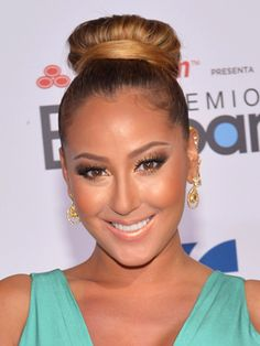 53a62a3eee1 Adrienne Bailon looks radiant and bronzed. Get the look by using a gold  shadow on