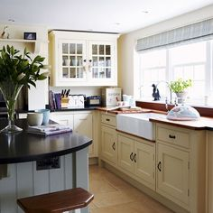 cream kitchen cabinets & tile floor - love a Belfast sink!