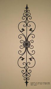 Tuscan Wrought Iron Wall Decor - can be hung vertically or horizontally. To go in kitchen horizontally above painted area.  Find it at: http://www.tuscanhomedecorandmore.com/servlet/the-1715/TUSCAN-WROUGHT-IRON-MEDALLION/Detail#