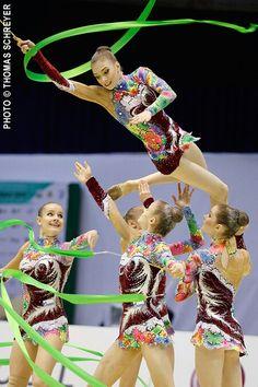 Rhythmic gymnastics group Rainbow Costumes, Lift And Carry, Rhythmic Gymnastics, Leotards, A Team, Olympics, Ribbon, Ballet, Dance