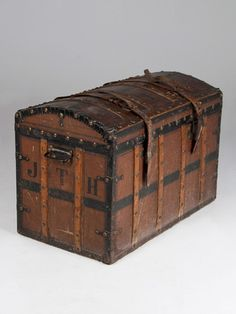 Antique Leather Steamer Trunk circa 1900 - I looooove old steamer trunks, and am lucky to have one that came with my war-bride grandmother when she emigrated in 1945 from England to Canada. It's very similar to this, but covered in brown-painted canvas instead of leather.