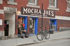 Typical scene downtown: bikes and coffee and a little resting spot. Flickr Group: Brattleboro 05301 Mocha Joe's by Nas Karas, via Flickr
